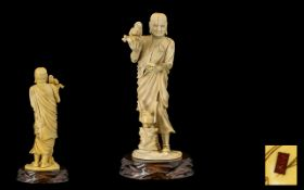 Japanese Tokyo School Signed - Finely Carved Ivory Okimono of A Priest Dressed In Flowering Robes,