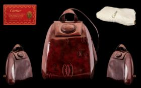 Cartier - Superb Quality Back-Pack Collectors Bag, In Burgundy Polyurethane Leather.