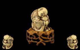Japanese - Late 19th Century Carved Ivory Figure Complete with Carved Wooden Display Stand.