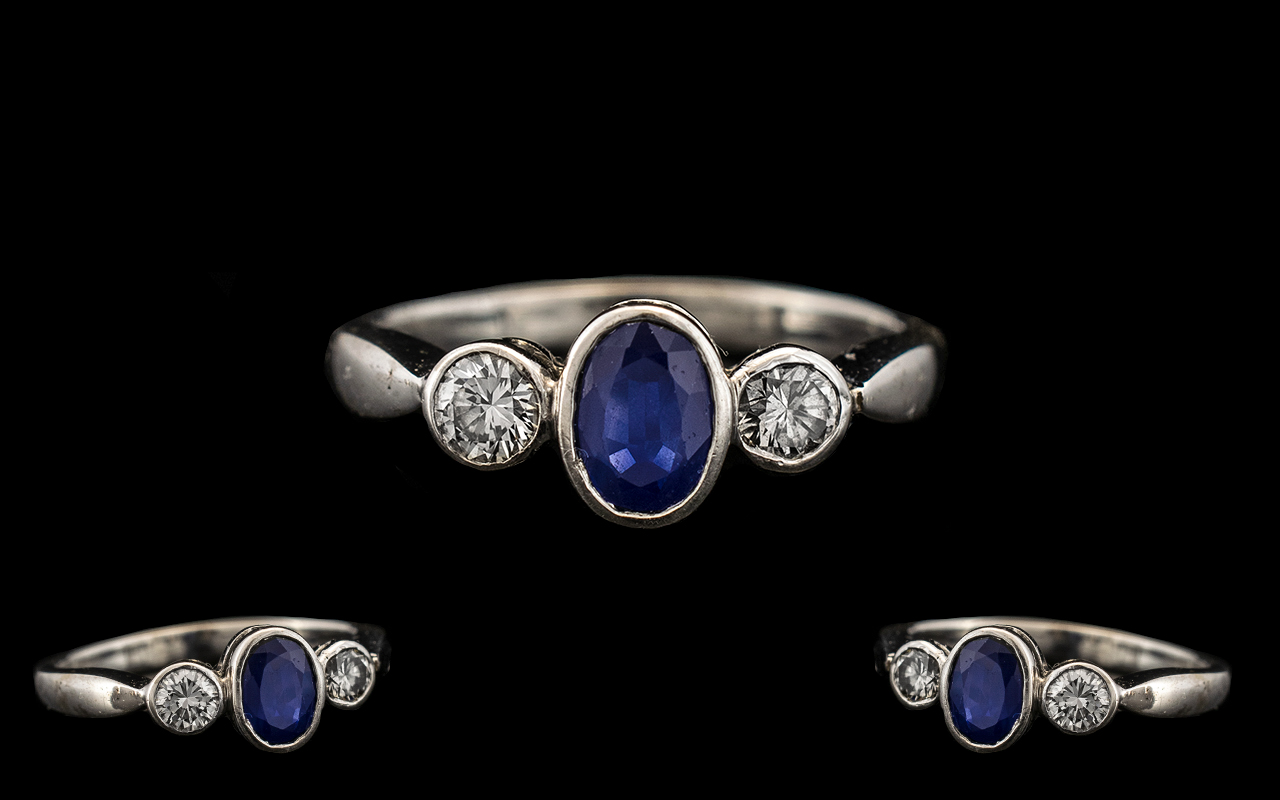 Lot 25A - 18ct White Gold - Attractive Sapphire and Diamond 3 Stone Dress Ring From the 1950's.