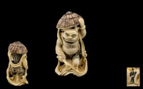Finely Carved Okimono of a Japanese Demon. 20thC. Signed to base, Coloured decoration to the body.