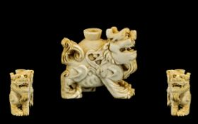 Chinese Antique Ivory Snuff Bottle in the form of a kylin, finely carved and detailed.
