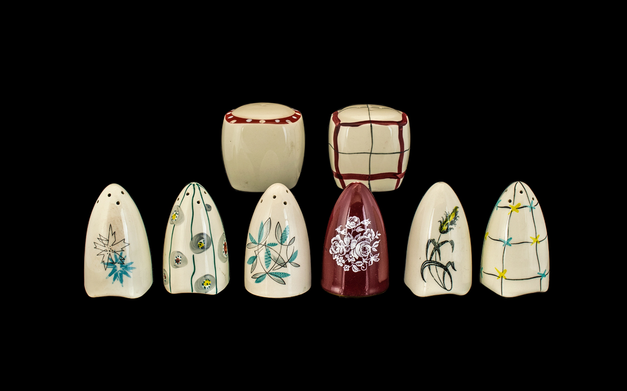 Lot 686 - Midwinter Eight Assorted Salt and Pepper Pots. Various designs and patterns.