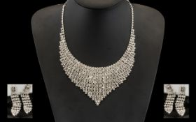 White Crystal Bib Necklace and Drop Earrings Set, a V shaped panel fully set with brilliant white