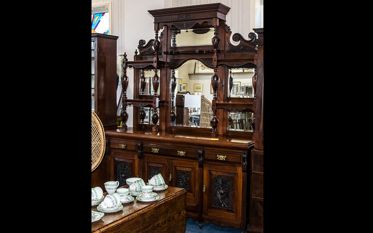 Lot 1054 - Large Edwardian Mahogany Mirrored Back Sideboard, with triple mirrors and shelving to the mirror.