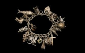 Vintage Silver Bracelet, Loaded with ( 18 ) Silver Charms of Good Quality and Interest.