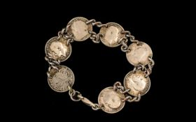 Silver Coin Bracelet, Some of the Coins Dating Back to the Victorian Days. 7 Inches In length.