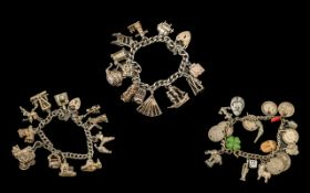 Three Silver Charm Bracelets Loaded With Numerous Charms To Include Coins, Church, Scales, Pram,