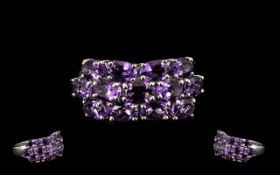 Amethyst Three Row Cluster Ring, 5.5cts of oval cut, deep purple amethysts set in three rows in