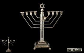Silver Hanukkah Menorah Surmounted With Star Of David Above A Circular Tapering Column Raised On A