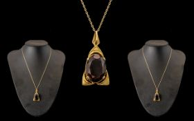 9ct Large Smokey Topaz Pendant on a 9ct Gold Chain Large Stone 2 cm In length.