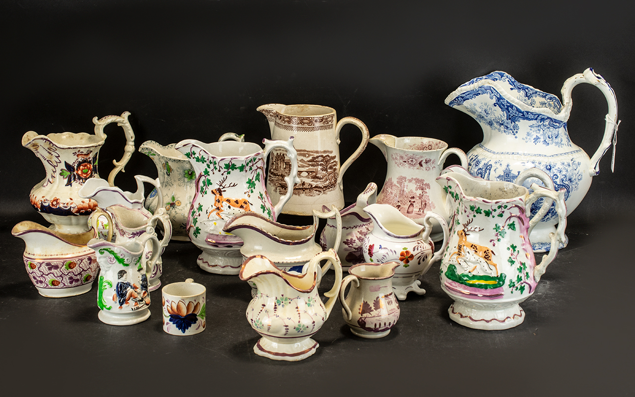 Lot 665 - A Collection of 20 Antique Pottery Staffordshire Jugs various shapes and sizes and decorations.