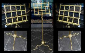 A Victorian Brass Telescopic Music Stand, fretwork music rest on a plain telescopic support.