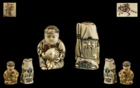 Two Japanese Ivory Netsukes finely carved with a boy holding a fish and a wise man holding a scroll.