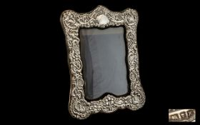 Edwardian Style Large and Ornate Sterling Silver Photo Frame of Pleasing Proportions. Marked K.F.