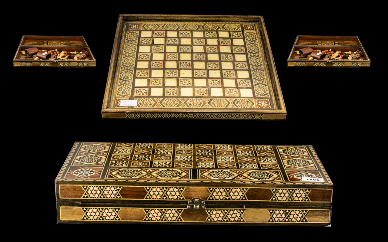 Lot 1400 - Moroccan Wooden Chess Set - Housed in an inlaid Back-Gammon case, with outer Chess board inlaid.