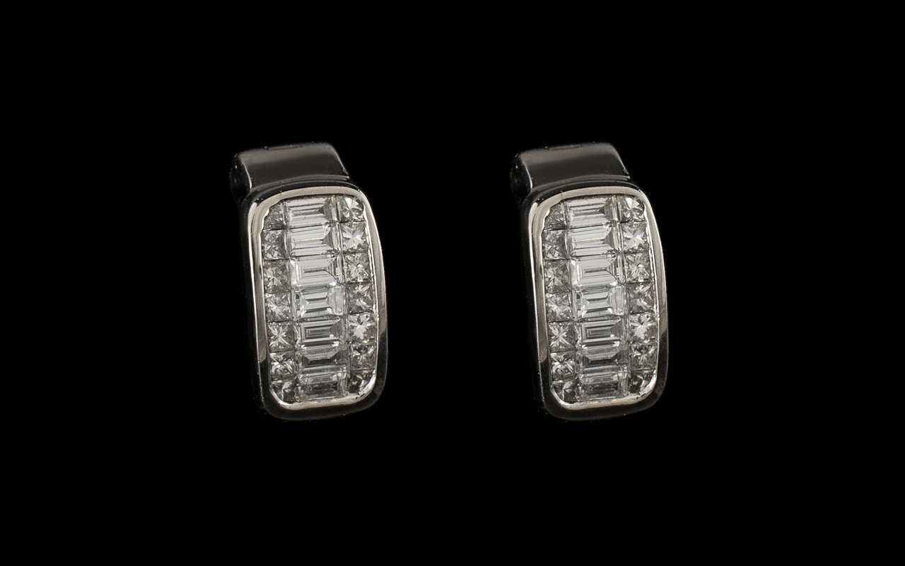 Lot 7 - A Superb Pair of Diamond Earrings Set In Platinum.