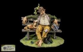 Capi-de-Monte Figure of The Tramp, Modelled by Toni Gingiano. 12 Inches Wide & 9 Inches High.