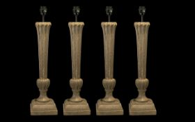 Collection of Four Modern Table Lamps, manufactured by Oka, or classical fluted columns in a stone.