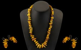 A Modern Reconstituted Amber Free form Necklace. Length 22 inches.