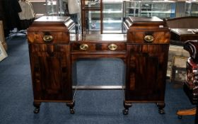 A Late Georgian Mahogany Sideboard with conversions with a well centre supported by pedestal