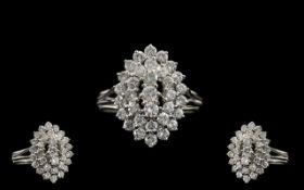 Platinum - Superb Quality Diamond Set Cluster Ring, Boat Shaped Design on 3 Steps Raised.