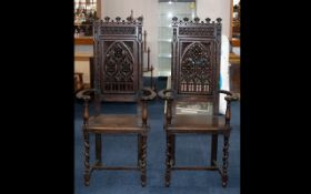 A Pair of French Gothic Revival Monks Chairs in stained beechwood with a profusely carved back of