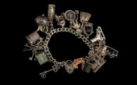 Sterling Silver Curb Bracelet Loaded with 17 Good Quality Old Silver Charms.