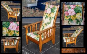 Liberty Retailed Type, Patented Arts & Crafts Child's Reclining Armchair in golden Tiger Oak, the