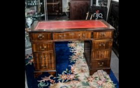 A Modern 20thC Pedestal Desk red tooled leather top with three frieze drawers above two banks of