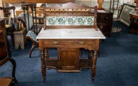 Late Victorian Stained Beechwood Marble Top and Washstand with low tiled back with turned spindles.
