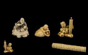 Japanese Carved Ivory Parasol Handle plus three ivory netsukes of men and boys (4)