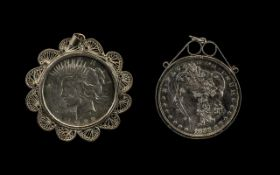 Two American Silver Dollars in Pendant Mounts dated 1883 and 1922.