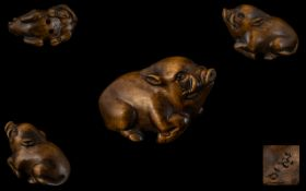A Japanese Carved Boxwood Netsuke In The Form of a Wild Boar, Excellent Condition In All Aspects.