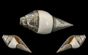 An Antique Tibetan Conche Shell Horn, Mounted In Silver, Finely Embossed with Floral Decorations and