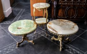 Italian 1960s Set of Onyx Topped Coffee Tables on cast brass bases and shaped legs.