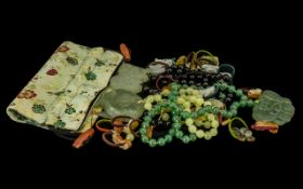 Three Jade Flower Pendant Necklaces with silk cord and back detail and Chinese.