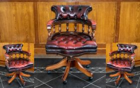 An Oxblood Leather Captain's Chair with buttoned seat and backrest. Height 34 inches.