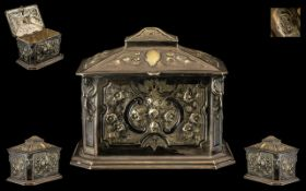 Victorian Sarcophagus Shape Silvered Metal Lidded Tea Caddy with embossed floral decoration and