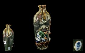 Japanese Stoneware Partially Glazed Vase, with the figure of a small boy, playing with a ball,