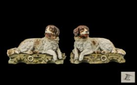 Pair of Victorian Bisque Reclining Newfo