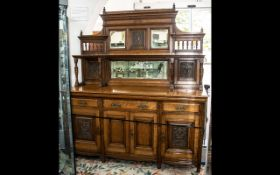 Edwardian Oak Mirror Backed Sideboard with a low mirrored back with side shelves,