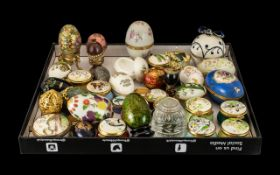 Large Collection of Decorative Ceramic & Metal Eggs & Boxes,