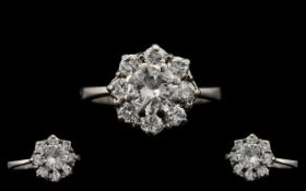 Stunning 18ct White Gold Attractive Diamond Set Cluster Ring, The Single Central Round Brilliant Cut