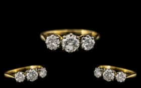 18ct Gold Attractive 1930s Three Stone Diamond Set Dress Ring marked 18ct to interior of shank.