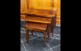 """Nest of Three Tables, raised on four legs, largest 23"""" width x 15"""" depth x 20"""" height."""