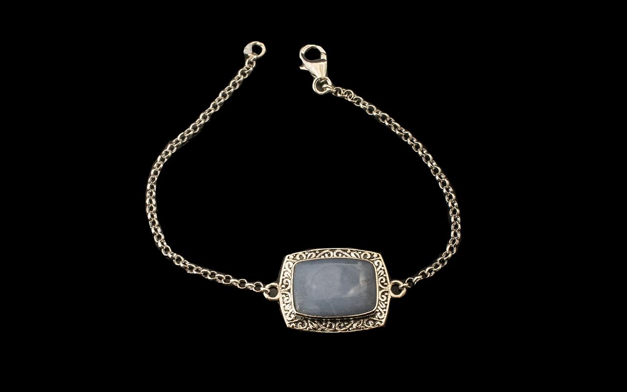 Angelite Centrepiece Bracelet, a 10ct cushion cut, rectangular cabochon of angelite,