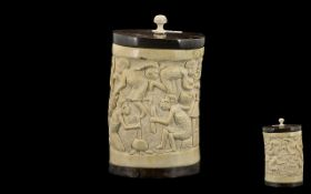 African Carved Ivory Lidded Vase Depicting Village Crafts and Women Cooking, Ebony Wood Base and