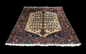 Persian Carpet with a tree design to the central panel,
