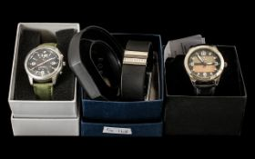 Three Contemporary Quality Watches in original boxes with instructions,